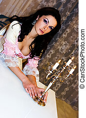 Lady with candles - Beautiful brunette girl with nice makeup...