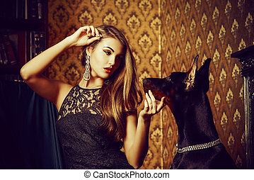 lady with dog - Charming young woman with her dog in a room ...