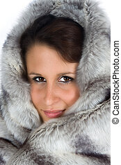 Attractive young woman wearing a fur cape