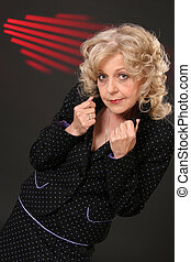 Mature blond lady with red stripes