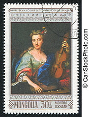 lady with Viola da Gamba - MONGOLIA - CIRCA 1968: stamp...