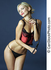 Lady with whip - Portrait of the beautiful young blonde lady...