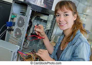 Lady working on dismantled computer