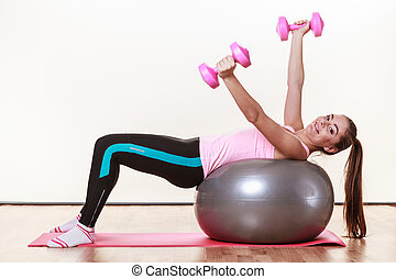 Lady working out with dumbbells. - Sport, fitness, people,...