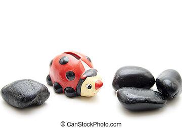 Ladybird with black stones