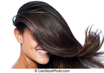 Lady's face covered with long straight hair - Smiling pretty...