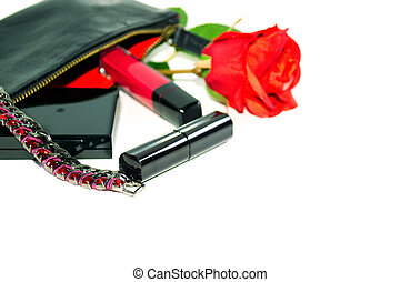 Lady's goods: make up bag, cosmetics and fashion jewerly on white background with soft shadows.