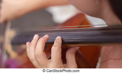 Lady's Hand Playing the Cello