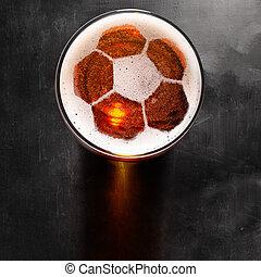 lager beer on table - soccer or football ball symbol on foam...