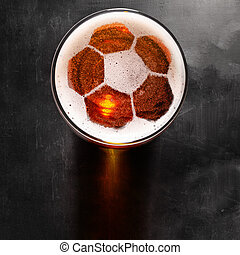 lager beer on table - soccer or football ball symbol on foam...