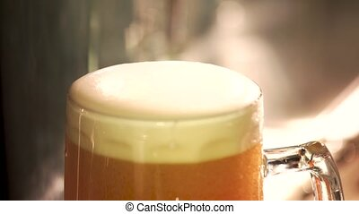 Lager froth cutting with knife, close up. Foamy head of...