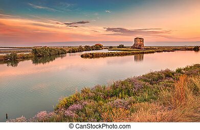lagoon of Comacchio, Ferrara, Italy - landscape at sunset of...