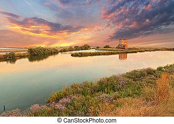 lagoon of Comacchio, Ferrara, Italy - landscape at sunset of...