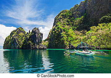 Lagoon - Traditional filippino boat in the sea, Philippines