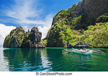 Lagoon - Traditional filippino boat in the sea, Philippines