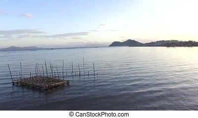 Laguna de Bay huge lake replete with man made bamboo...