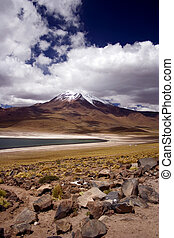 Laguna Miscanti surrounded by volcanoes, Atacama Desert,...