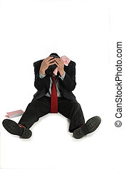 Laid off businessman sits depressed on the floor, isolated...