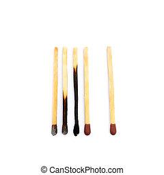 Laid used matchsticks
