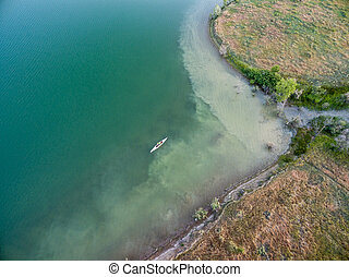lake and canoe aerial view