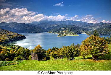 Lake and meadow in countryside of Romania, Bicaz