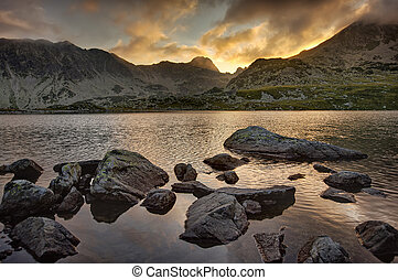 lake and mountain at sunset