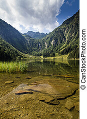 Lake and mountains view in high Alps