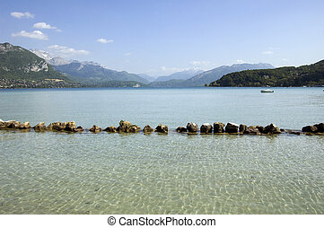Lake Annecy and mountains - View of Lake Annecy with a row...