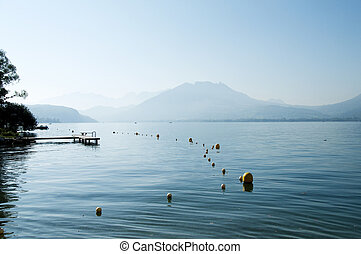 Lake Annecy with diving board and buyos - View of lake...