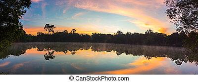 lake at sunrise on mountain