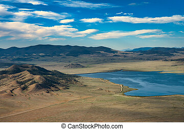 Lake at the end of a road. View of hills and mountains from hot air balloon ride in colorado