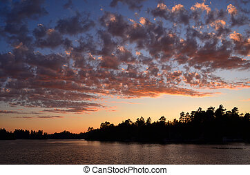 The sun's remnant light reflected in the clouds and the lake at Temagami, ON.