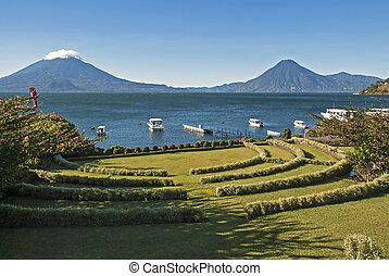 Lake Atitlan with volcanoes in background - Lake Atitlan in ...