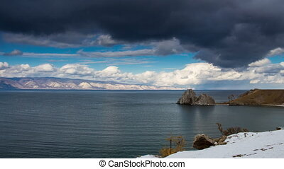 Lake Baikal landscape. Magnificent scenery. Blue sky, thunderclouds. Time lapse