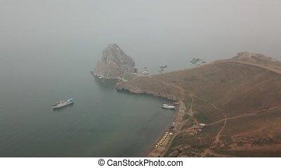 Lake Baikal. Olkhon Island in the summer Shamanka in fog ...