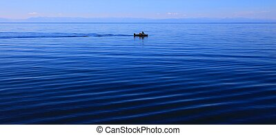 Lake Baikal, summer. Motor boat in middle of the lake.