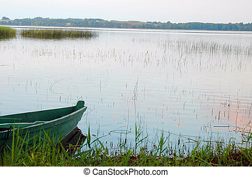 lake bank  - boat on lake bank