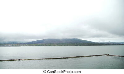 Lake Batur in the crater of a volcano. View of volcano mount...