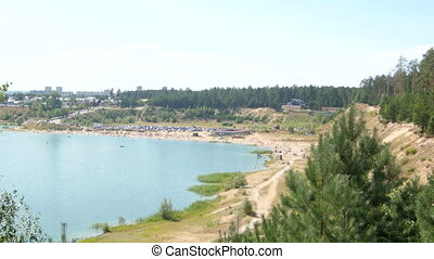 Lake beach in forest. View from top