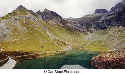 Panoramic view of beautiful lake between alpine tops