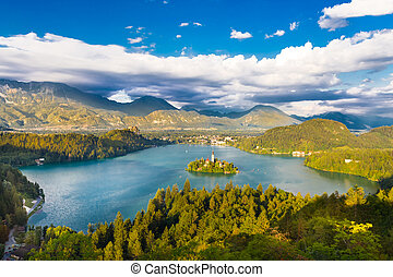 Panoramic view of Julian Alps, Lake Bled with St. Mary´s Church of the Assumptionon on the small island; Bled, Slovenia, Europe.
