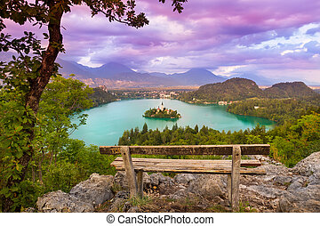 Sunset panoramic view of Julian Alps, Lake Bled with St. Marys Church of the Assumption on the small island; Bled, Slovenia, Europe.