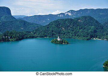 Lake Bled, island with church in front of hills