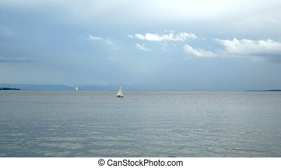 Lake Bodensee on a cloudy day where yachts swim.