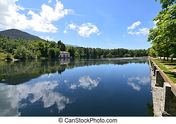Lake Called The Sea With A House On The Other Side Of The Shore And The Clouds Reflected In The Water In The Gardens Of The Farm. Art History Biology. June 19, 2018. La Granja Segovia Spain.