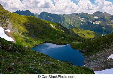 lake Capra in Fagarasan mountains of Romania. beautiful...