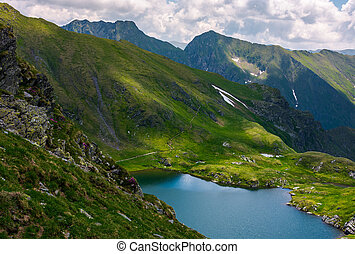 lake Capra in Fagarasan mountains of Romania. beautiful...