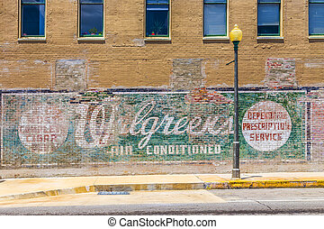 Lake Charles, USA - AUGUST 9:   old painted advertising at the wall on August 9, 2013 in Lake Charles, USA. Painted ads on brick walls were common in the first alf of last century in america.