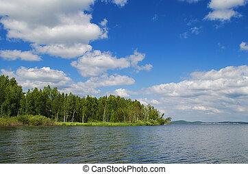 Lake Chernoistochinskoe in summer day. Russia, Ural