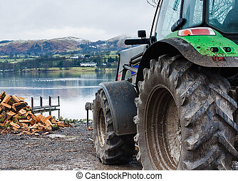 Farmers tractor with Lake District National Park scene in the Background and fells beyond